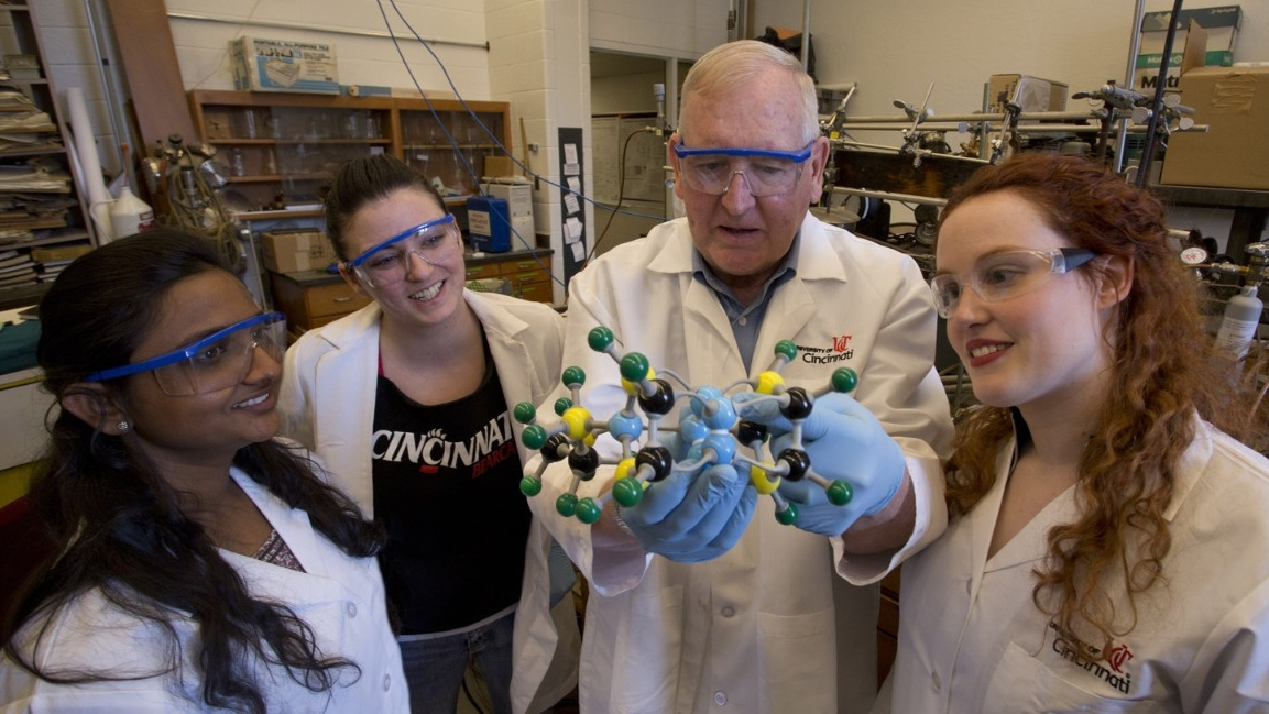 UC Chemistry students investigate a molecular model with a professor