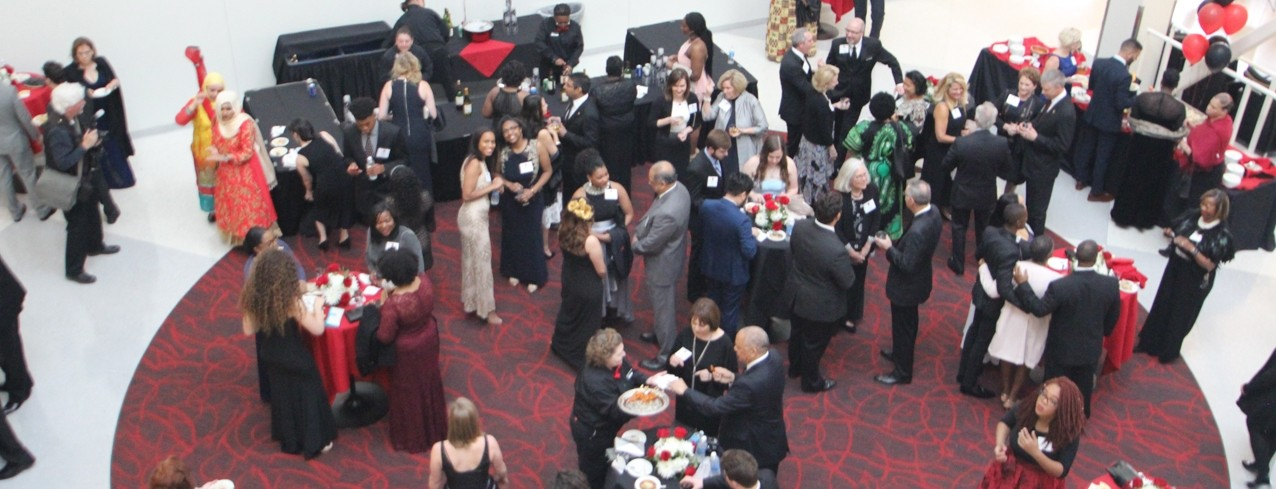 Guest are mingling at a cocktail reception in the Tangemann University Center atrium.