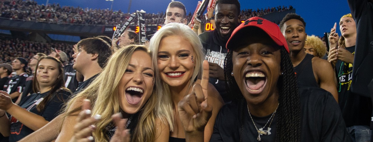 UC students cheering during a home football game