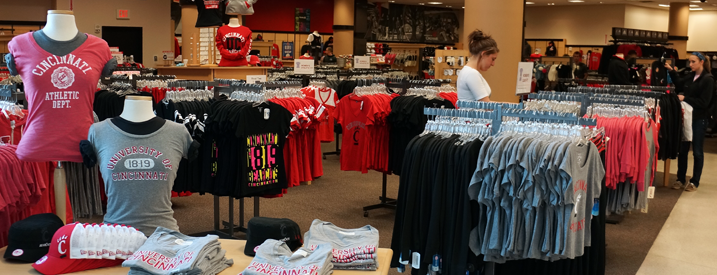 University of Cincinnati Bookstore with tables and racks of licensed UC product.