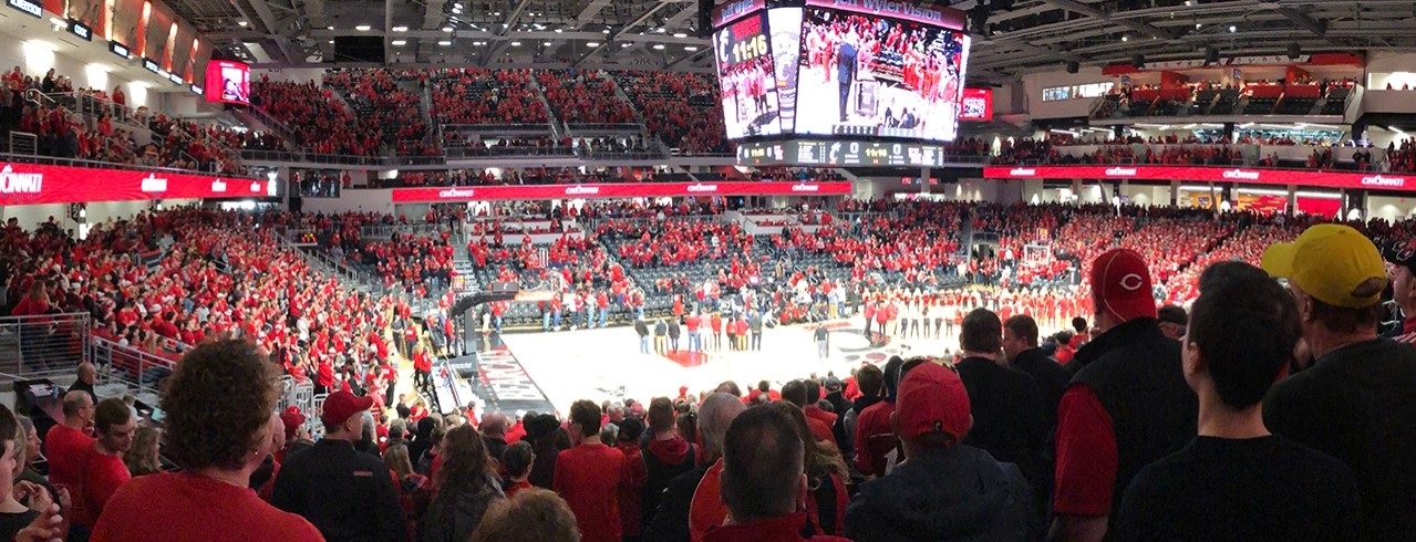 The UC Fifth Third Arena packed with fans watching a UC Men's Basketball Game.