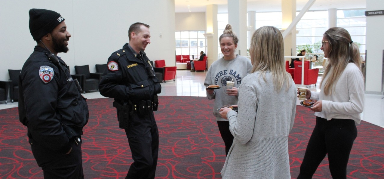 A UCPD officer talks to students during an event.