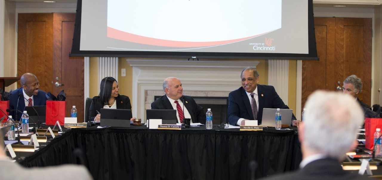 UC President Neville Pinto talks with the Board of Trustees during a meeting.