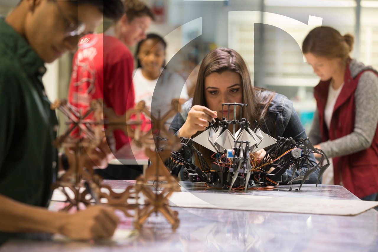 A DAAP student constructs a model