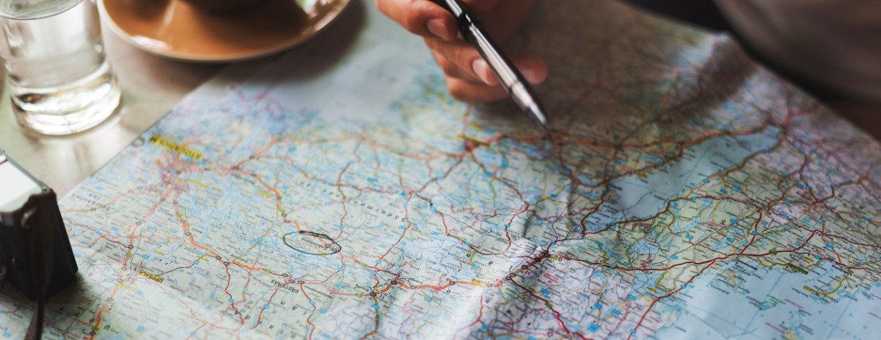 An indiscernible location is circled on a map.