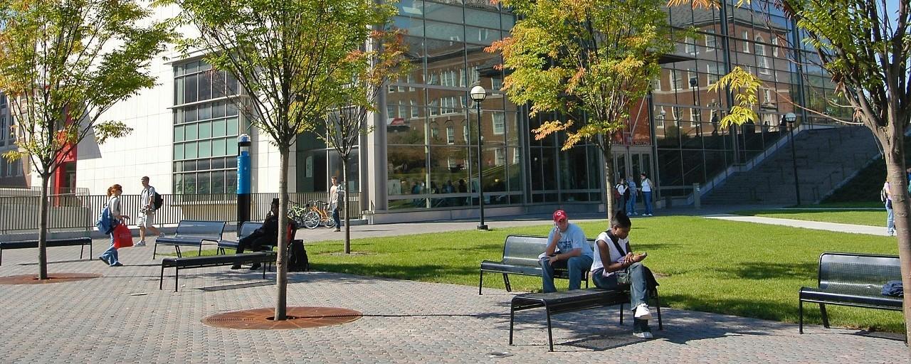UC Students sitting at University Pavilion