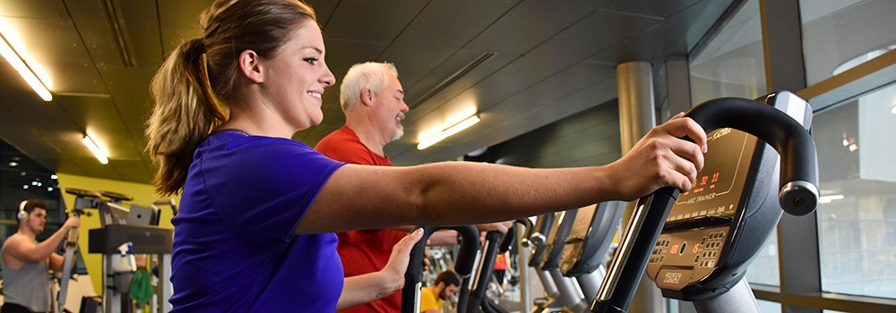 Guests exercising on treadmills at the Campus Recreation Center.