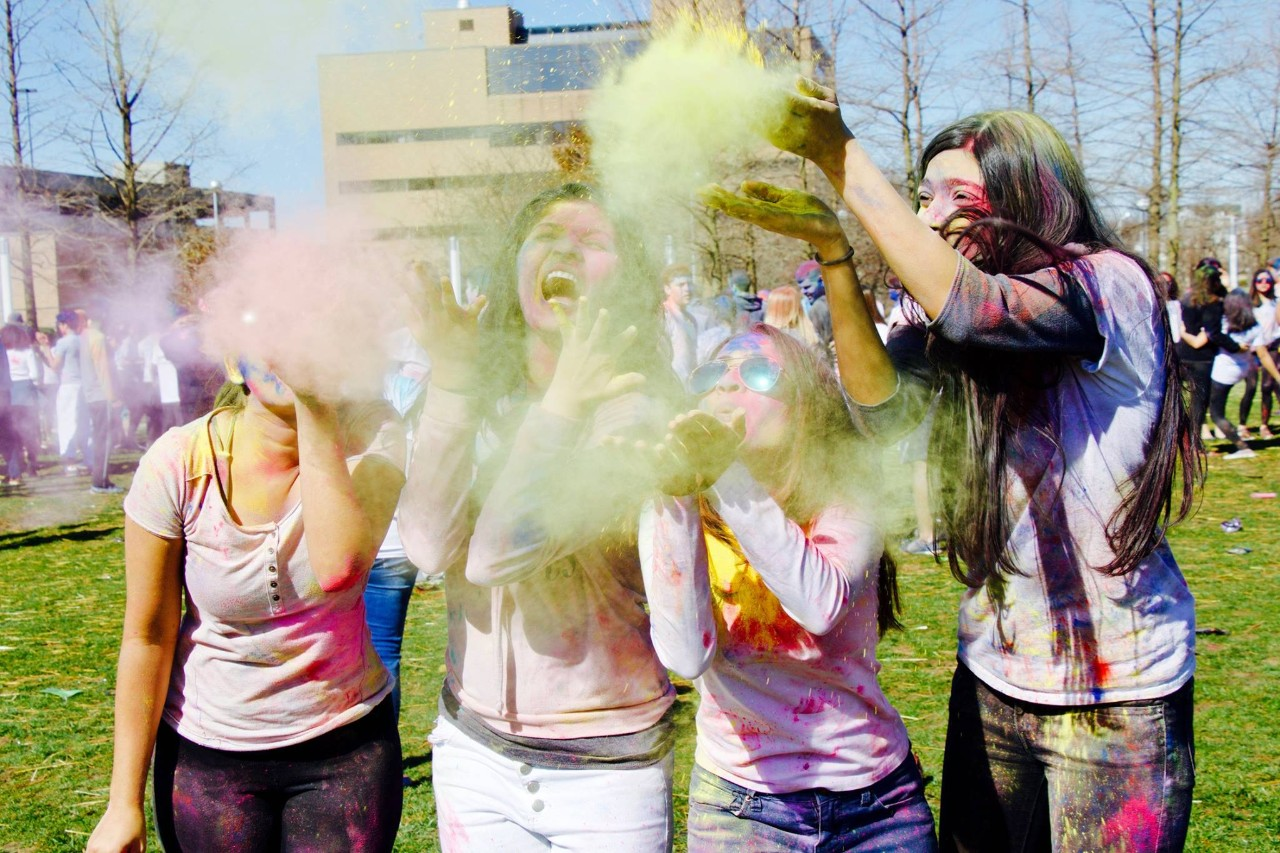 Group of 4 womxn at 2018 WorldFest event Holi