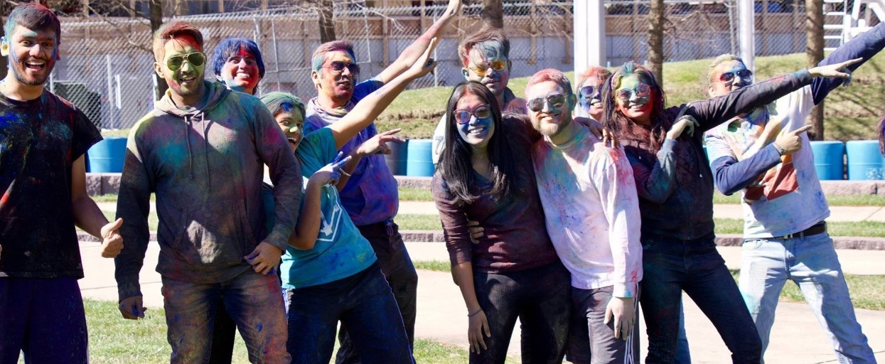 Students celebrating at the Holi Festival