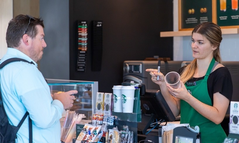 A student gives his order to the clerk at Starbucks.
