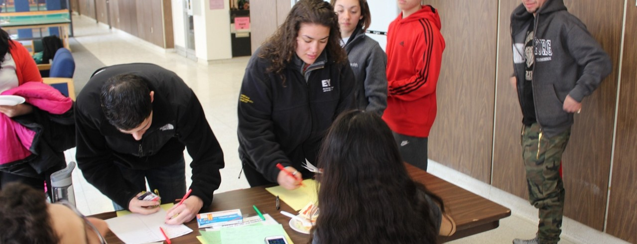 Students check in on move-in day at table.