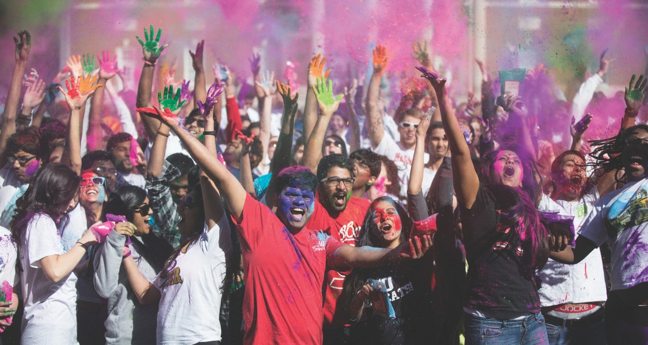 Students partake in color throwing and dance during the Holi festival of color, 2015.