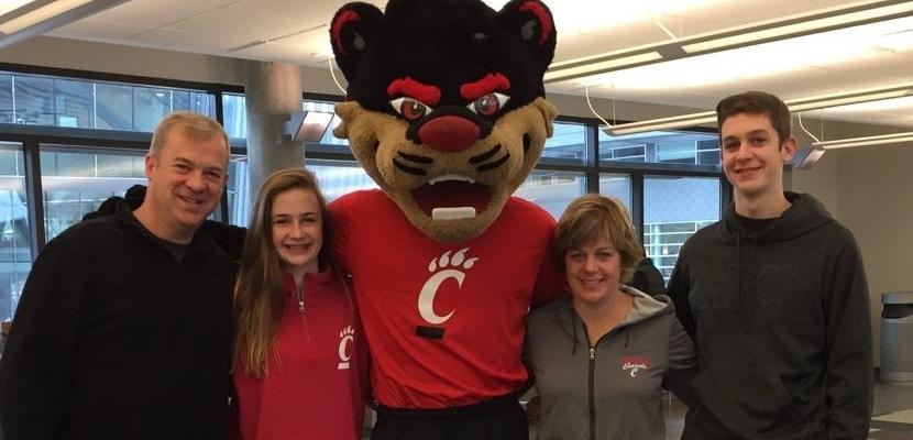 Family members posing with the Bearcat