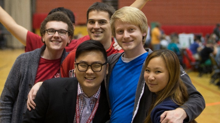 Students pose for a group photo at a UC Video Game competition