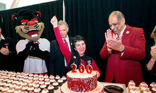 Kimberlee Dobbs celebrating UC's Bicentennial with President Pinto, and the Bearcat mascot