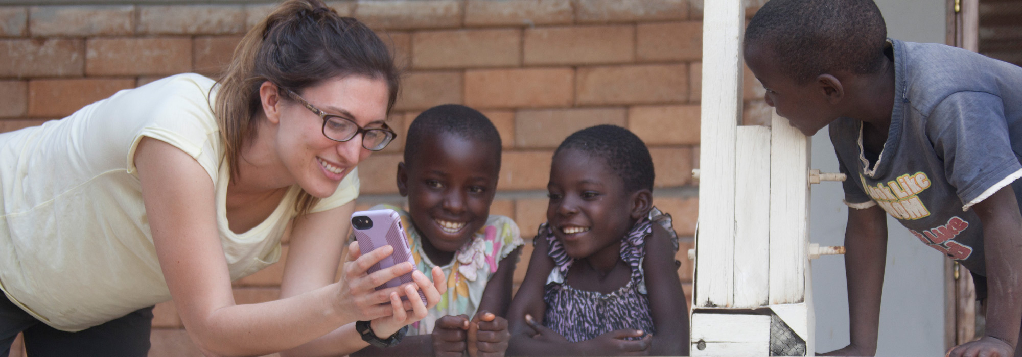 Med student Diandra Fortune shares photos from her phone with young children in Tanzania