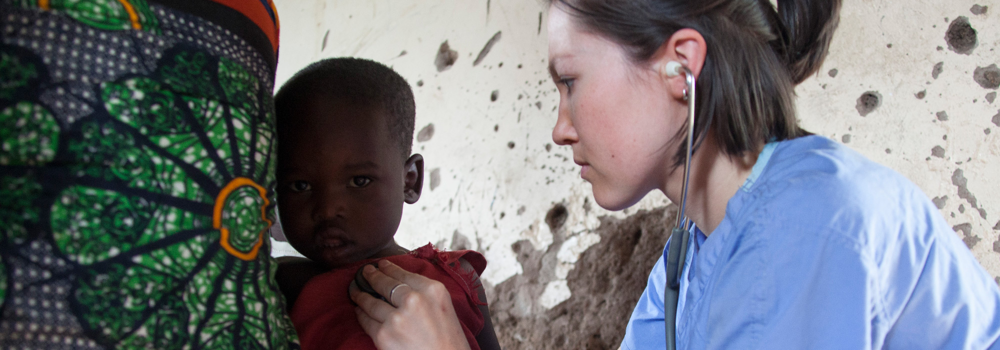 UC Med student Katie Brown examines a child in Tanzania