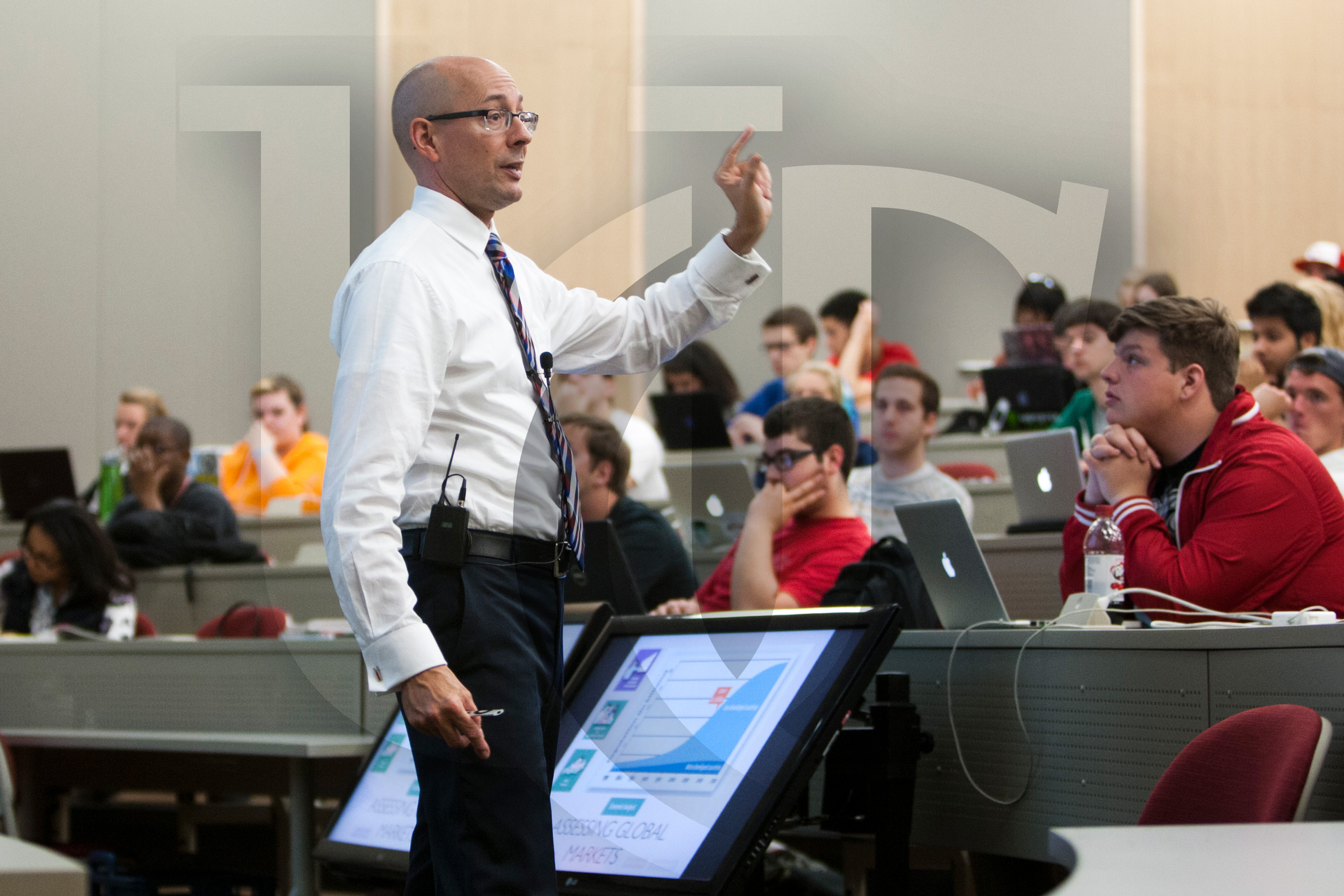 A UC professor speaks in a lecture hall