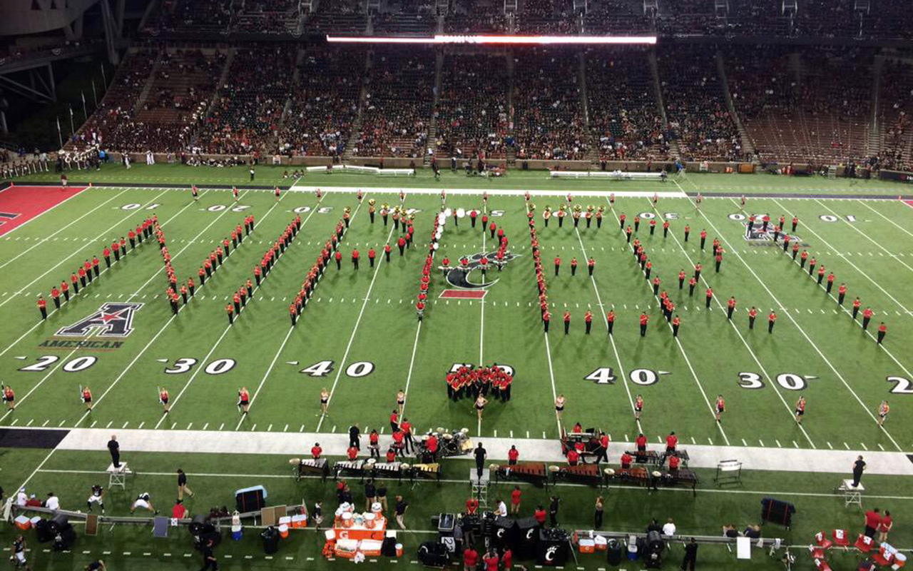 Nippert Stadium field with the band spelling out the word Nippert