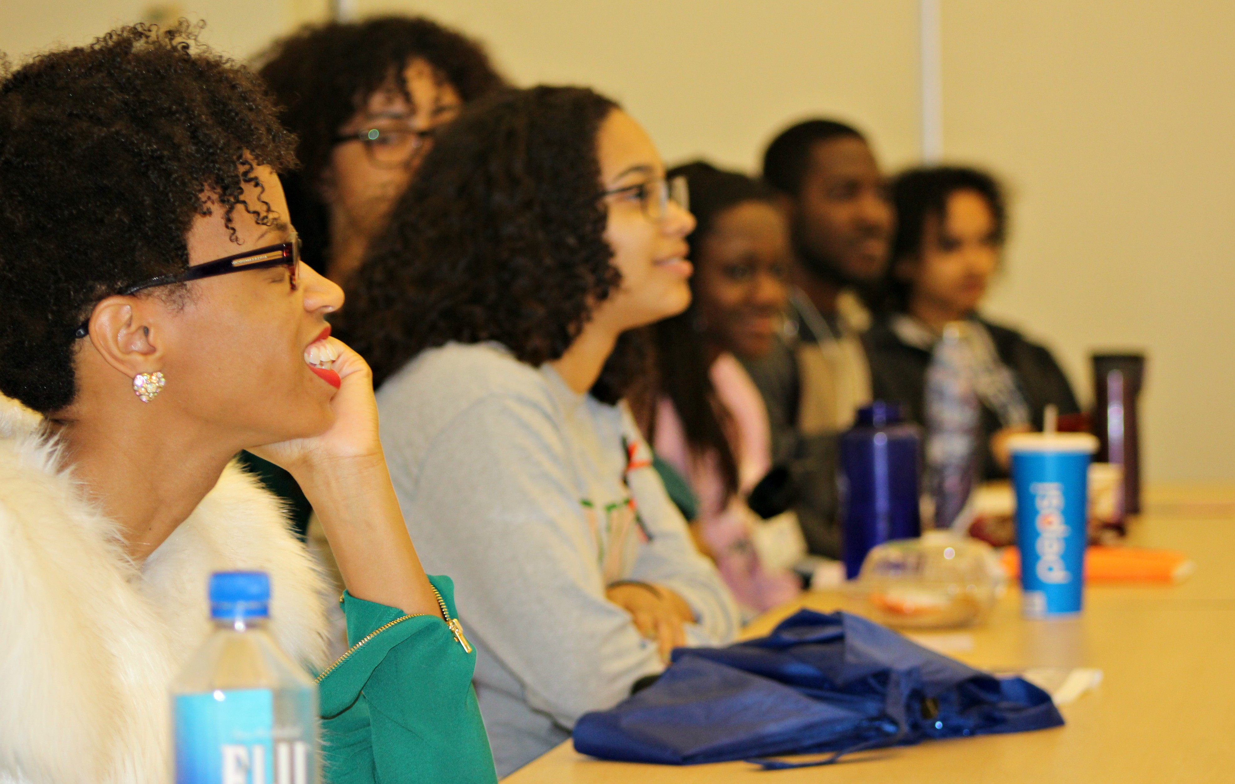 Black students smiling at the Black Feminist Symposium.
