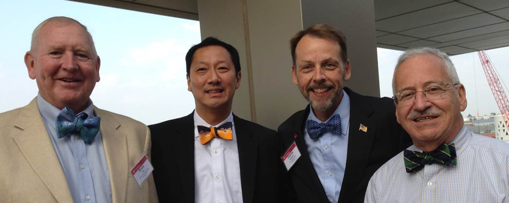 AFTL members with President Ono wearing bowties