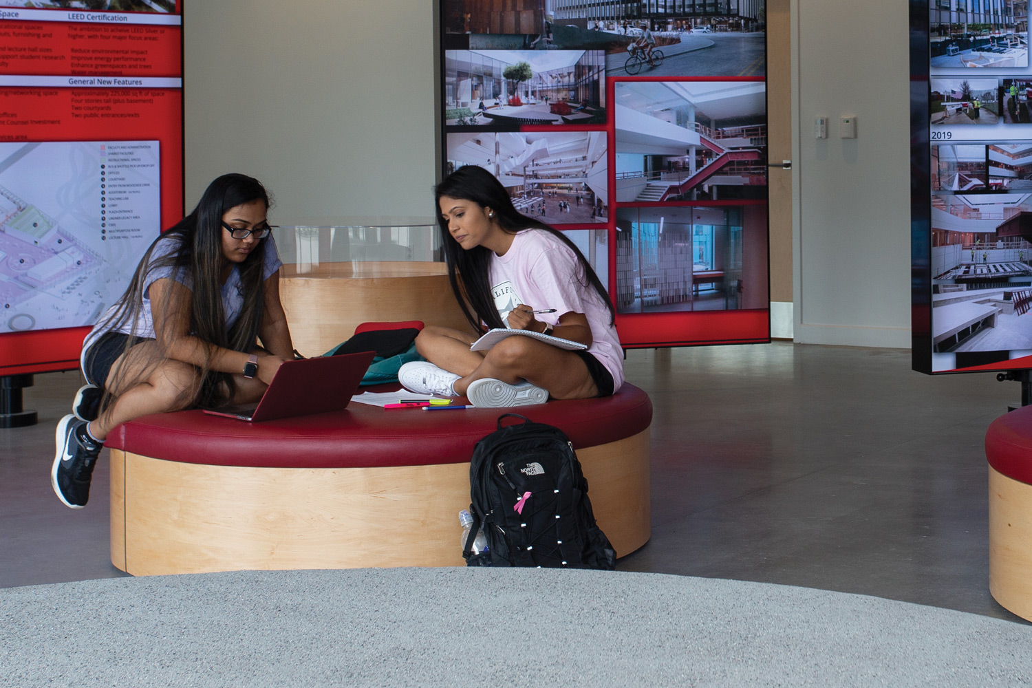 Students converse in the lobby of the all new Lindner College of Business