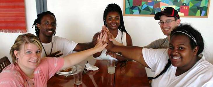 Erin, Leroy, Jaz, Michael, and Maya connect hands