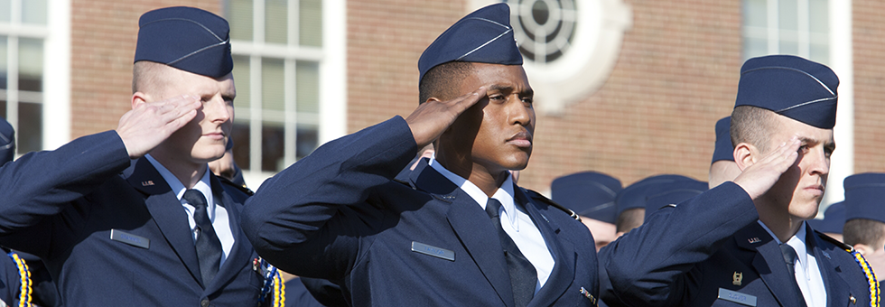 ROTC students saluting the flag.