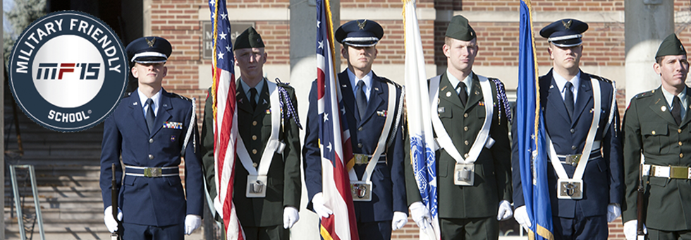 Army and Air Force ROTC members presenting the colors.