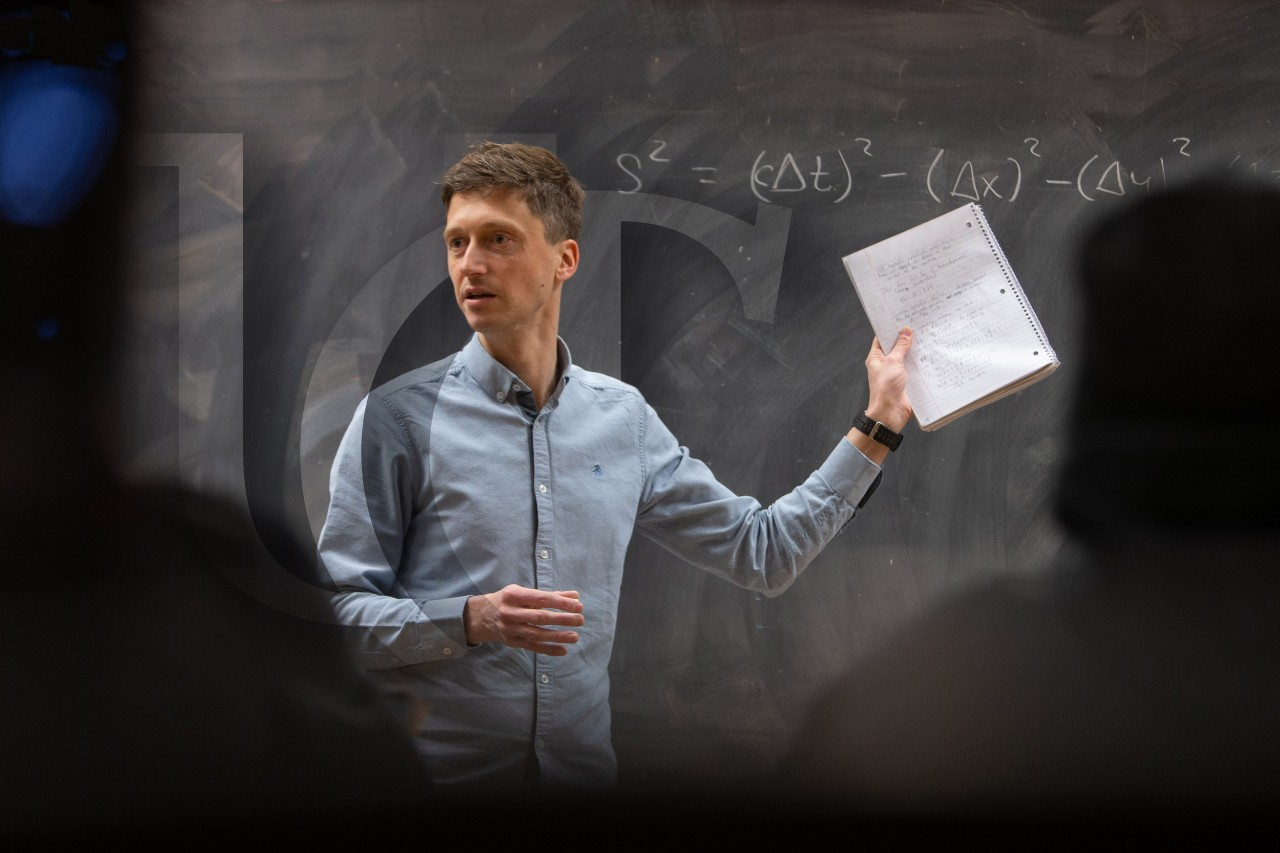 A UC professor speaks to a class