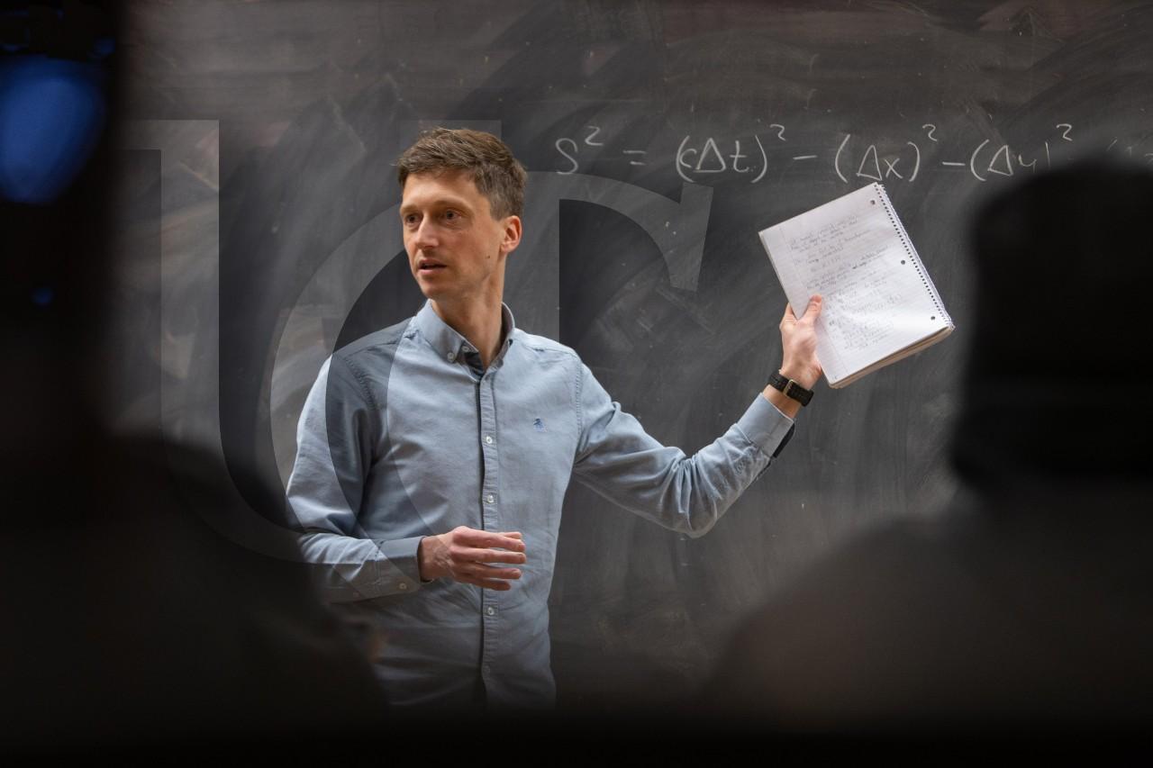 A UC professor speaks to a class