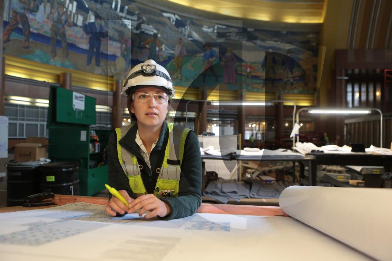 A UC co-op student looks at blueprints at Cincinnati's Union Terminal