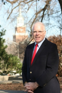 Photo of professor O'Reilly standing in front of tower