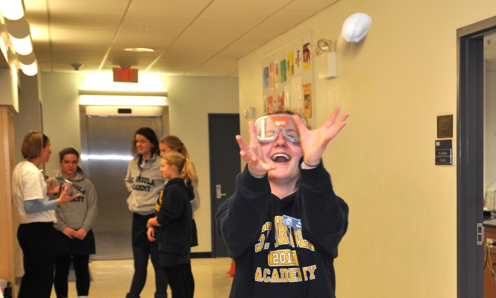 St Ursula student catches ball with goggles.