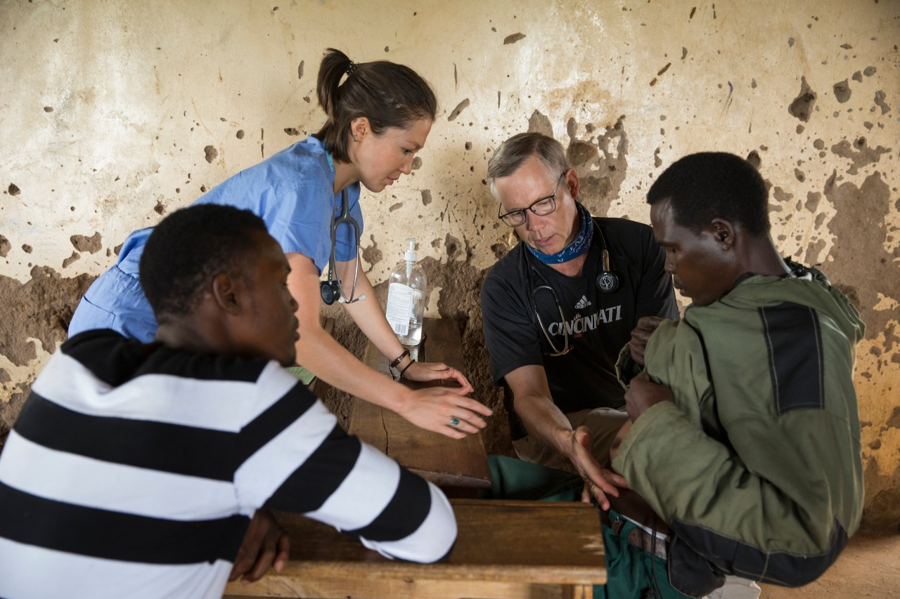 UC medical team sees a patient complaining of belly pain at a free clinic in Tanzania