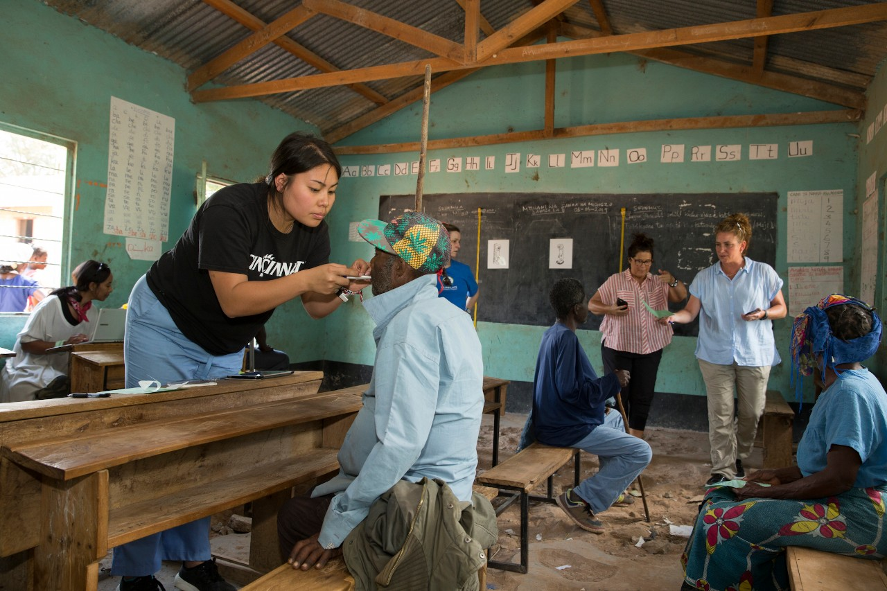 A UC nursing student takes a patient's temperature at a clinic in Tanzania