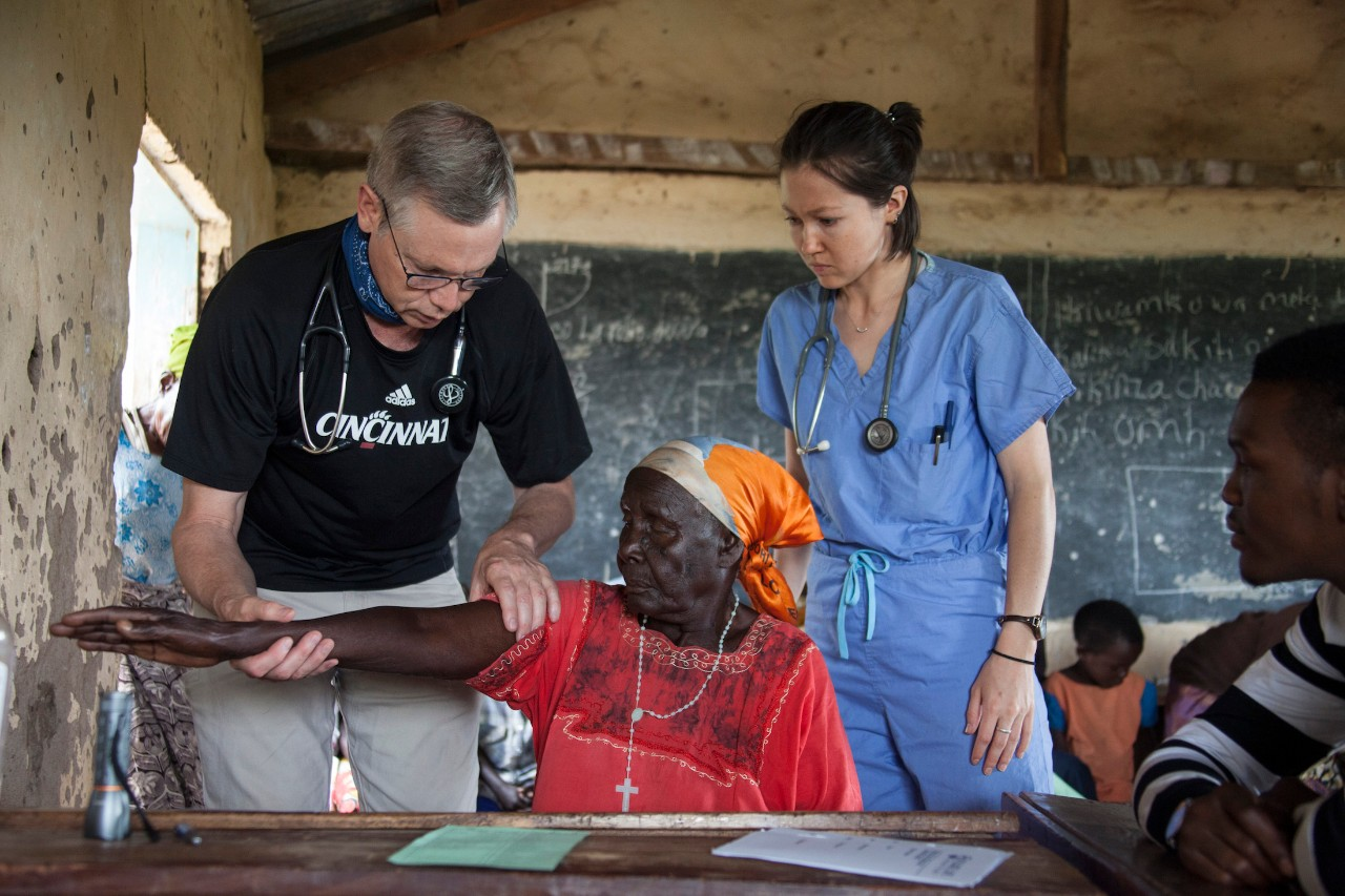Dr. Art Panioli and student Katie Brown diagnose a patient at a clinic in Tanzania