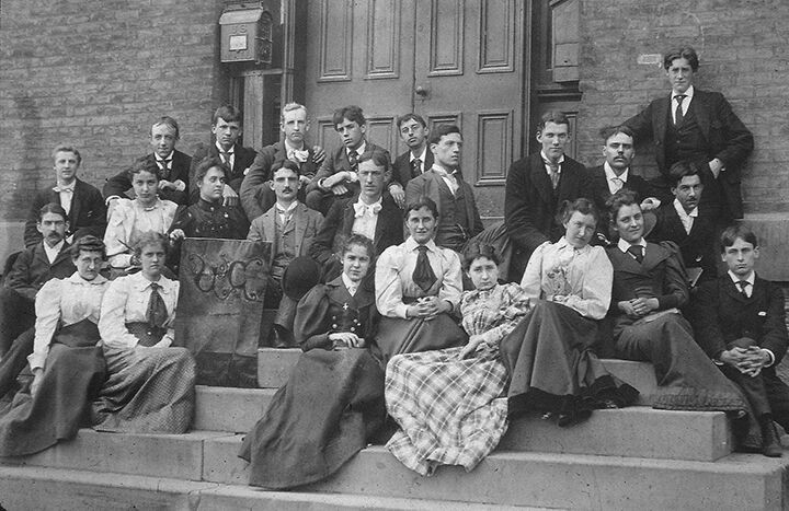 1800s students sitting on steps