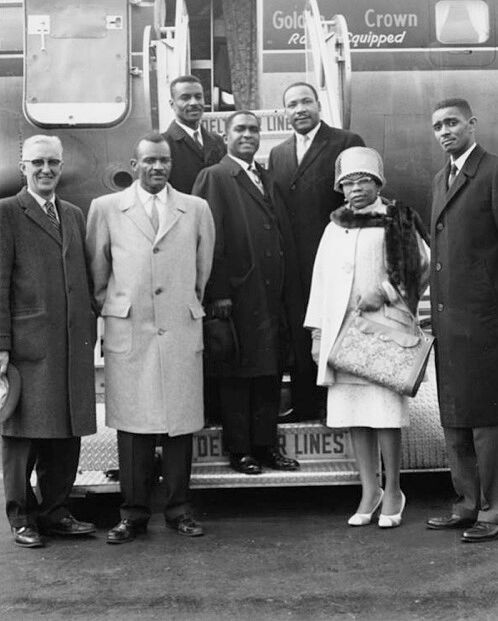 Black and white photo of a group of people including Venchael Booth and Martin Luther King, Jr.