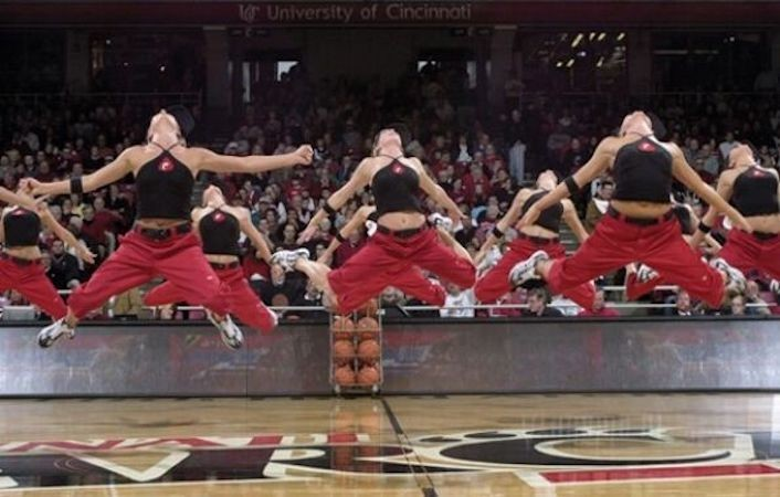 UC's dance team jumping in the air