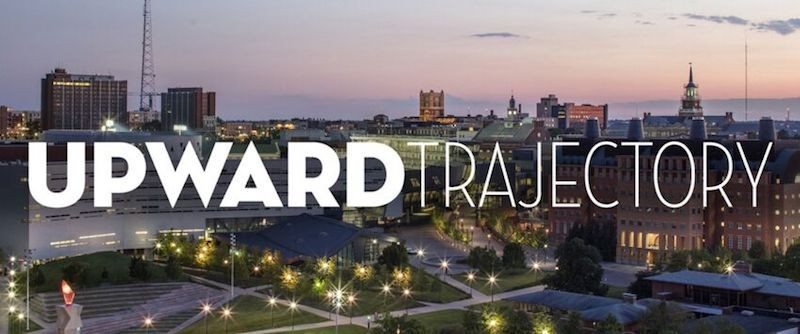 """Photo of campus with the phrase """"upward trajectory"""""""