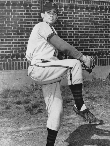 Black and white photo of Sandy Koufax pitching