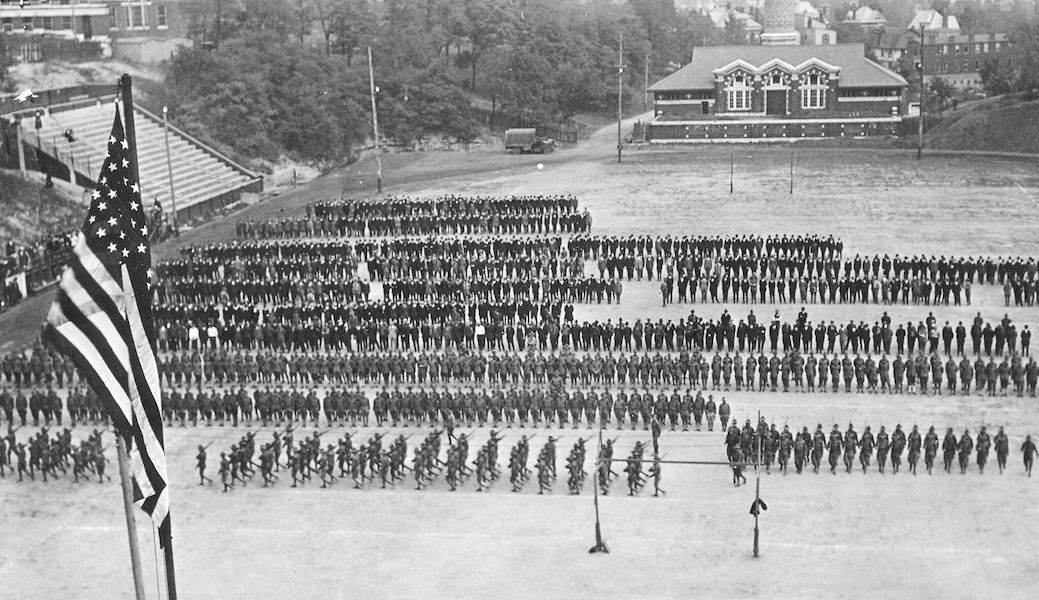 Black and white photo of soldiers lined up on a field