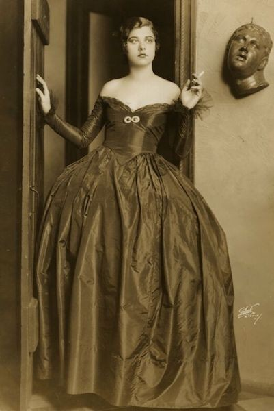 Black and white photo of Libby Holman in a gown