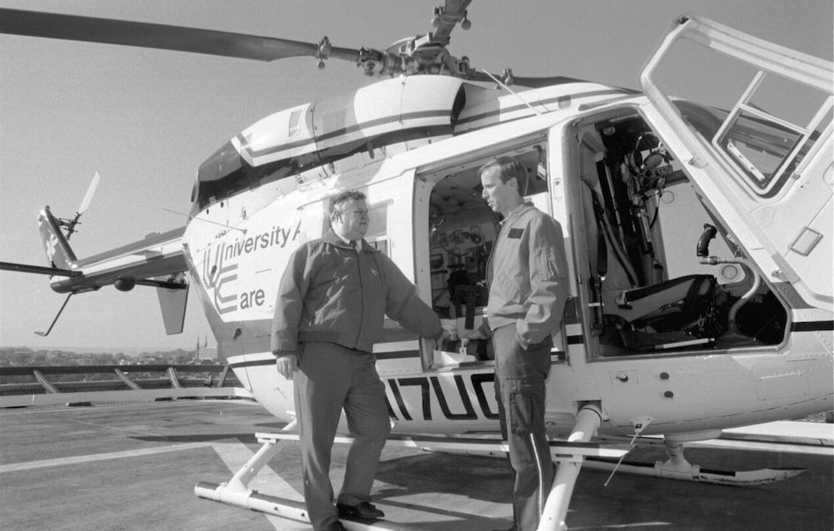Black and white photo of UC air care helicopter