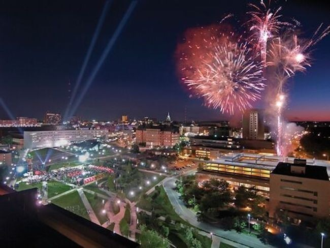 Fireworks over campus at night