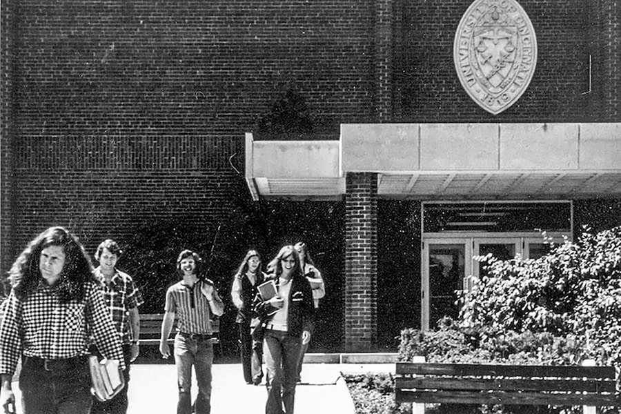 Black and white photo of students walking out of a building in late 1960s