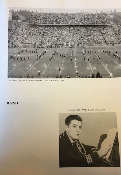 Yearbook page featuring the UC marching band and director