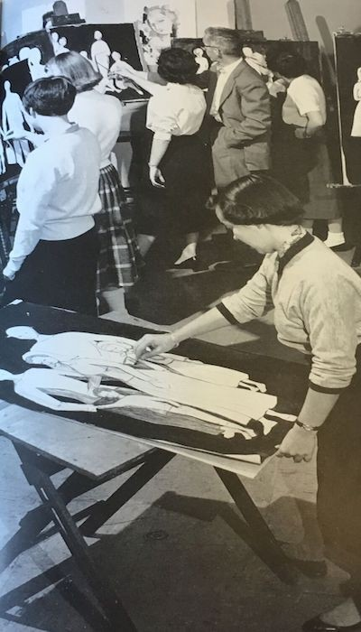 Black and white photo of an art student drawing