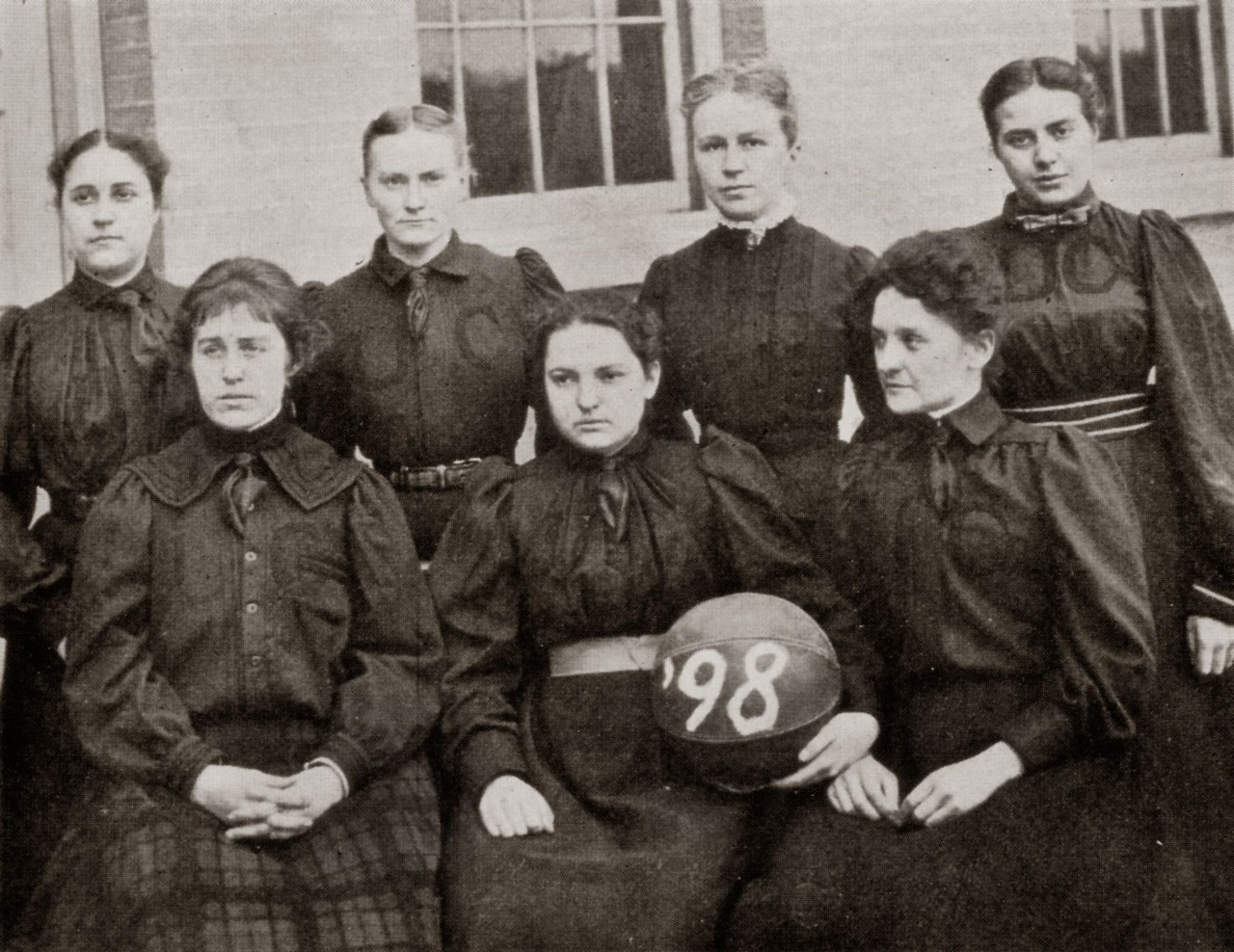 Black and white photo of 1898 women's basketball team
